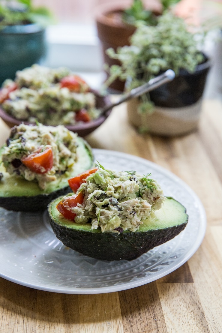 Healthy Greek Tuna Salad Stuffed Avocadosmade with fresh ingredients for a healthy lunch | TheRoastedRoot.net #keto #paleo #lowcarb