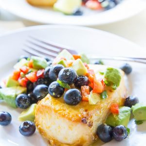 Orange Ginger Halibut with Blueberry Avocado Salsa - a baked halibut recipe that is easy to prepare and so flavorful! A healthy dinner recipe - paleo, whole30, low-carb | TheRoastedRoot.net