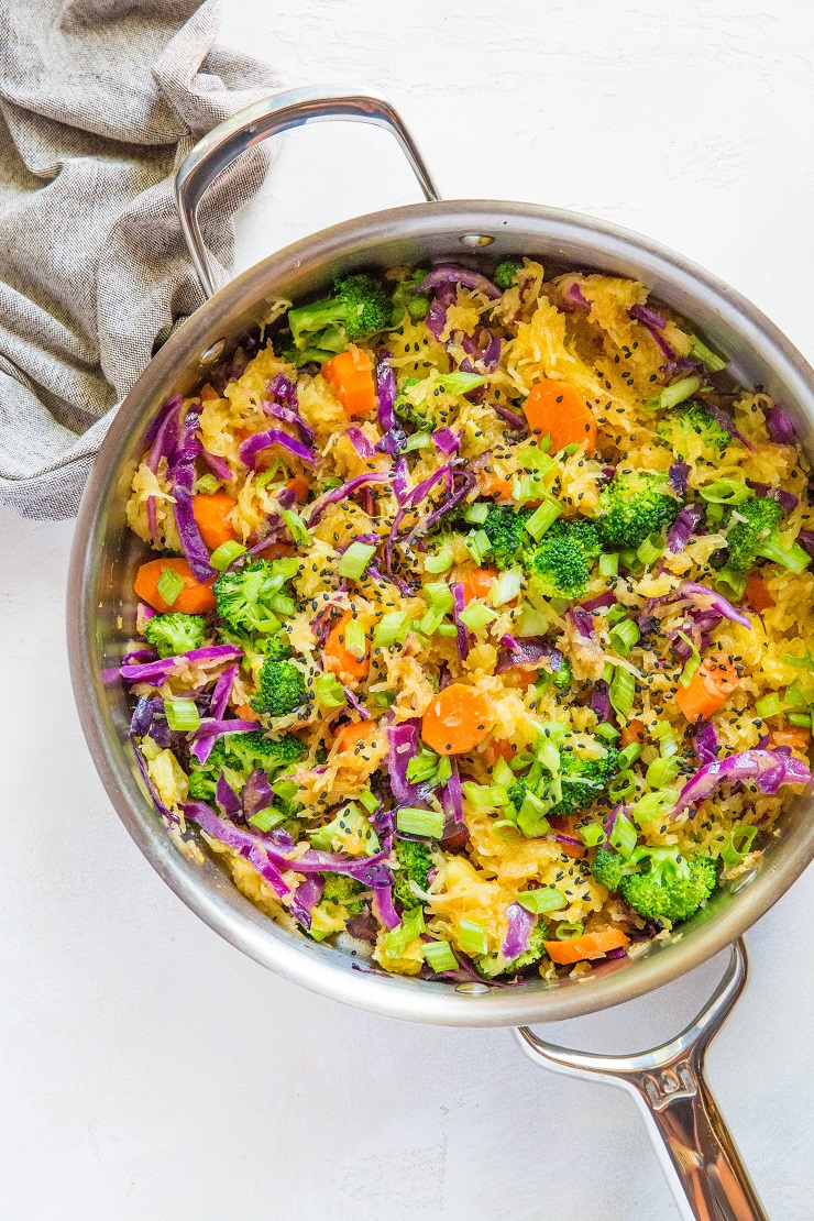 Spaghetti Squash Stir Fry with carrots, broccoli, cabbage, green onion, ginger, and coconut aminos - an easy paleo side dish | TheRoastedRoot.net #glutenfree