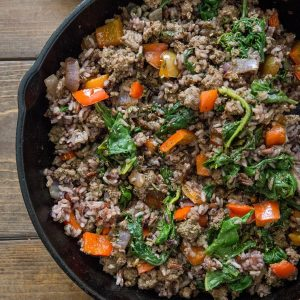 One-Skillet Ground Beef and Wild Rice with onion, garlic, rainbow chard, and bell pepper - an easy, quick well-balanced meal recipe ready in under 1 hour | TheRoastedRoot.net