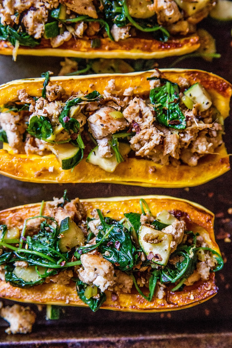 Ground Turkey Stuffed Delicata Squash with zucchini, spinach, ginger, and coconut aminos - paleo, whole30, Low-FODMAP, low-carb, and AIP dinner recipe!   TheRoastedRoot.net