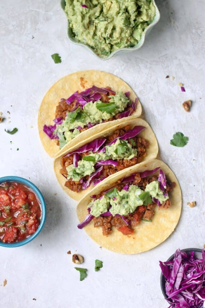 """The best healthy Vegan Chickpea Walnut Tacos with a super """"meaty"""" filling made with mushrooms, chickpeas, walnuts, and homemade taco seasoning. This recipe makes a lot of """"meat,"""" so it's great for a crowd!"""
